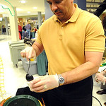 Rich Resendez of Vermilion Police Dept. serves Some Like It Hot at the 11th annual Zero-Proof Mix-Off at LCCC on Dec. 6.  Steve Manheim
