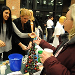 Loretta Rouse, on right, of Avon, receives a 'Zoe's No Hangover Razberry Mocktail' from Zoe Colaso, on left, alongside Darlene Colaso, of the Oberlin Underground Railroad Center,  at the 11t …