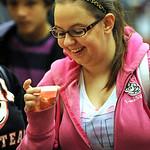 Rachel Taylor, a LCCC student from Elyria, tries the Cherry Bomb drink by Lorain County Metro Parks, at the 11th annual Zero-Proof Mix-Off at LCCC on Dec. 6.  Steve Manheim