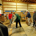 Eighteen alpacas got their yearly trimming Sunday at Top Knot Alpaca Farm in Grafton Township. Wool from the previous alpaca is swept up while the next one is brought in. It takes five or si …