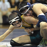 Lorain's Dominic Diaz, top, defeats Amherst's Anthony Mendez in 106 wt. class at Lorain on Jan. 12.   Steve Manheim