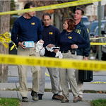 An FBI evidence team prepares to search the Cleveland home of Anthony Sowell on Friday, Nov. 13, 2009. The remains of 11 women were discovered in the house. (AP Photo/Mark Duncan)