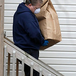 An investigator carries out an evidence bag from the home of Anthony Sowell Wednesday, Nov. 18, 2009, in Cleveland. Investigators looking into the discovery of 10 bodies and a skull at the h …