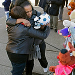 Nancy Johnson hugs Barbara Dixon, left, next to a small memorial across the street from he home of Anthony Sowell on the east side of Cleveland Friday, Nov. 6, 2009. The remains of 11 women …