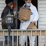 An investigator carries out bags of evidence from the home of Anthony Sowell Wednesday, Nov. 18, 2009, in Cleveland. Investigators looking into the discovery of 10 bodies and a skull at the  …