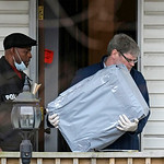 An investigator carries out evidence from the home of Anthony Sowell Wednesday, Nov. 18, 2009, in Cleveland. Investigators looking into the discovery of 10 bodies and a skull at the home of  …