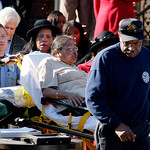 Inez Fortson is wheeled to an ambulance after she had to leave the funeral of her daughter, Telacia, at Grace Missionary Baptist Church in Cleveland, Thursday, Nov. 12, 2009. Telacia Fortson …