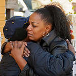 Nancy Johnson, right, hugs a woman next to a small memorial across the street from he home of Anthony Sowell on the east side of Cleveland Friday, Nov. 6, 2009. The remains of 11 women were  …