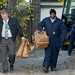Cleveland Police investigators carry evidence bags from behind the house adjacent to Anthony Sowell's on Imperial Ave. in Cleveland Wednesday, Nov. 11, 2009. The remains of 11 bodies were di …