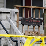 Police tape stretches across the porch at the home of Anthony Sowell Wednesday, Nov. 4, 2009, in Cleveland. Sowell, 50, has been charged with five counts of aggravated murder and held withou …