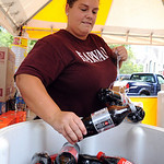 Jessica Harrah of Jems Concessions in Amherst sets out Cokes at Elyria Apple Festival Sep. 16.  Her stand will sell funnel cakes and french fries.  Steve Manheim