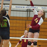 Avon Lake Isabelle Wagner hits over Amherst Kristy Koller Oct. 27.  Steve Manheim
