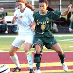 Avon Lake's #6 Kailey McClain fights Amherst's #8 Dominica Essi for the ball.