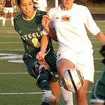 Amherst's #8 Dominica Essi fights Avon Lake's #1 Sarah Nasr for the ball.
