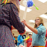 Kristen Gould, 10, of Avon Lake, has a ballon caterpiillar made by Whipples the Clown at the Avon Lake Homecoming Festival Oct. 2. The annual event featured community booths, vendors, kids …
