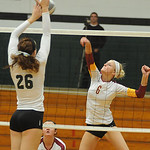 Avon Lake Katie Mihalik tips over EC Caitlyn Rock Oct. 3.  Steve Manheim