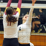 EC Catherine O'Shaughnessy tips past Avon Lake Katie Coughlin Oct. 3.  Steve Manheim