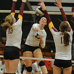 EC Maryssa Kellcik hits between Avon Lake 13 Isabelle Wagner and Christine Bohan on Oct. 3.  Steve Manheim