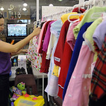 Angela Cruzado of North Ridgeville, browses through clothes at the Kid's Kloset resale at Avon High Sep. 25.  Steve Manhiem