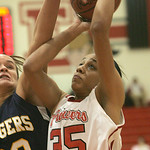 18JAN12  N. Ridgeville girls travel to Elyria High School. Lady Pioneer #35 Alexis Middlebrooks is fouled by Ranger #22 Bella Pecchia.      photo by Chuck Humel