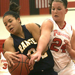 18JAN12  N. Ridgeville girls travel to Elyria High School.    Ranger #32 Brionna Rich and Lady Pioneer #24 Bergen Read fight for a loose ball.   photo by Chuck Humel