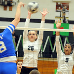 EC 26 Caitlin Rock and 9 Karissa McGrath defend against Bay Bridget Durham on Oct. 9. Steve Manheim