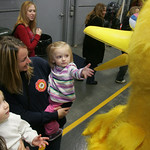 10NOV09  Peyton Teague, 18 mos, reaches out to ah, shake Big Bird's bill. He mom Melissa of Wellington is holding her.   At left, also of Wellington, is Finley Sasack, 14 mos and mom Amy.  B …
