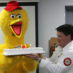 10NOV09 Wellington Fire Dept. Lt. Bill Brown helps Sesame Street's Big Bird (left), blow out the candles on his (Big Bird's) 40th Birthday cake. photo by Chuck Humel