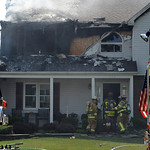 Amherst and Vermilion firefighters put out a second floor fire at a home on McIntosh lane in Amherst on July 5.  Steve Manheim