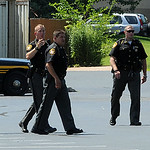 Lorain County Sheriff's deputies arrive in the parking lot behind DeLuca's Place in the Park in Lorain to search for evidence after an arrest on July 14. STEVE MANHEIM/CHRONICLE