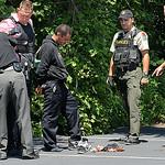 A Lorain County deputy arrests Robert Gauna of Bay Village after anElyria Township bank robbery. STEVE MANHEIM/CHRONICLE
