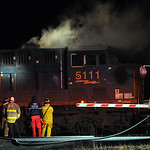 Wellingrton firefighters put out a CSX train fire at the crossing on Webster Rd. in Wellington on Mar. 5.  Steve Manheim