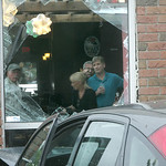 Patrons view the damage to Wolfey's.  MVA Car into Wolfey's Pub, E. Broad St, Elyria.    photo  by Chuck Humel