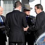 Gov. Dannel P. Malloy, right, talks with officials at a staging area following a shooting at the Sandy Hook Elementary School in Newtown, Conn., about 60 miles (96 kilometers) northeast of N &#8230;