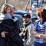 A young girl is comforted following a shooting at the Sandy Hook Elementary School in Newtown, Conn., about 60 miles (96 kilometers) northeast of New York City, Friday, Dec. 14, 2012. An off …
