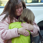 A mother hugs her daughter following a shooting at the Sandy Hook Elementary School in Newtown, Conn., about 60 miles (96 kilometers) northeast of New York City, Friday, Dec. 14, 2012. An of …