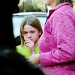 A young girl cires following a shooting at the Sandy Hook Elementary School in Newtown, Conn., about 60 miles (96 kilometers) northeast of New York City, Friday, Dec. 14, 2012. An official w …