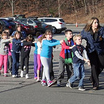 In this photo provided by the Newtown Bee, Connecticut State Police lead children from the Sandy Hook Elementary School in Newtown, Conn., following a reported shooting there Friday, Dec. 14 …