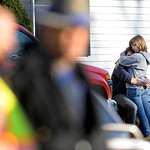 People embrace at a firehouse staging area for family around near the scene of a shooting at the Sandy Hook Elementary School in Newtown, Conn., about 60 miles (96 kilometers) northeast of N &#8230;