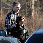 A man and woman leave the staging area for family around near the scene of a shooting at the Sandy Hook Elementary School in Newtown, Conn., about 60 miles (96 kilometers) northeast of New Y &#8230;