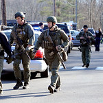 State Police are on scene following a shooting at the Sandy Hook Elementary School in Newtown, Conn., about 60 miles (96 kilometers) northeast of New York City, Friday, Dec. 14, 2012. An off …