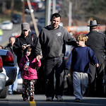 Parents leave a staging area after being reunited with their children following a shooting at the Sandy Hook Elementary School in Newtown, Conn., about 60 miles (96 kilometers) northeast of  …