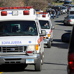 Ambulances leave an area near the scene of a shooting at the Sandy Hook Elementary School in Newtown, Conn., about 60 miles (96 kilometers) northeast of New York City, Friday, Dec. 14, 2012. …