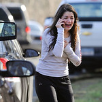 A woman waits to hear about her sister, a teacher, following a shooting at the Sandy Hook Elementary School in Newtown, Conn., about 60 miles (96 kilometers) northeast of New York City, Frid …