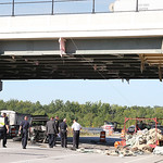 The damaged Jeep and a damaged trailer holding tarping material at the scene of the accident on I-90 under the Nagel Road overpass. A worker was killed in the accident.