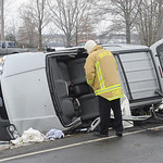 Oberlin fire chief looks over car involved in MVA at Oberlin Rd and Butternut Ridge Rd. Feb. 14. Steve Manheim