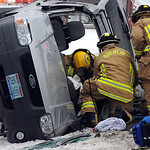 Oberlin firefighters work to remove a woman entraped in a vehicle involved in a twop-car MVA at Oberlin Rd. and Butternut Ridge Rd. in New Russia Twp. on Feb. 14. Steve Manheim