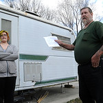 Michael Frost, with daughter Shelby, 13, holds the eviction letter sent to him to vacate Crystal Springs Campground in North Ridgeville,  on Apr. 3.  Steve Manheim