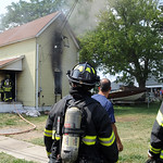 Elyria firefighters put out a house fire on Foster Ave. July 15.  Steve Manheim