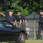 Elyria police and in the backyard at 619 W River Rd. N. shooting scene Jul 15.  Steve Manheim